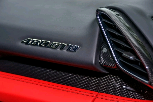 the-details-the-car-knows-its-name-and-theres-no-lack-of-carbon-fiber-topstitching-and-supple-red-and-black-leather_crop_600x400
